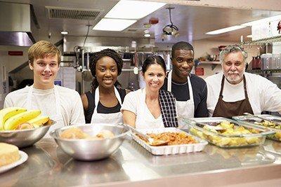 Volunteers Serving Meal